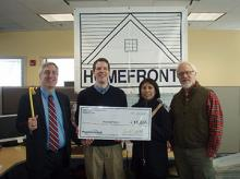 HomeFront Director Sean O'Brien (holding a big check); Vincent Santilli, Executive Director of the People's United Community Foundation (PUCF); and Fanny Ferreira, Vice President and Market Manager for People's United Bank